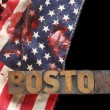 Bloodstains on USA flag with Boston word — Stock Photo