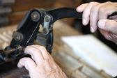 Letterpress printer cutting metal slugs — Stock Photo