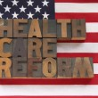 Health care reform words on USA flag — Stockfoto