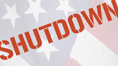 Shutdown word on old flag — Stock Photo