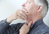 Man with throat or neck problems — Stock Photo
