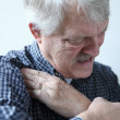 Man suffering from shoulder pains — Stock Photo
