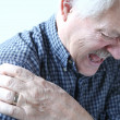 Shoulder joint pain in older man — Stock Photo