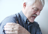 Bad pain in shoulder of senior man — Stock Photo