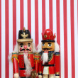 Nutcrackers on red and white stripes — Stock Photo