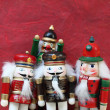 Group of nutcrackers on red background — Stock Photo