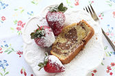 Marble cake slice with strawberries — Stock Photo