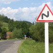 Stock Video: Road sign - hairpin bend