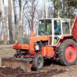 Stock Video: Orange wheeled tractor