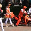 Promoters on motor-scooter — Vídeo Stock