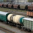 Railroad cars on a railway station. Cargo transportation - Stock Photo