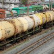 Set of tanks with oil and fuel transport by rail - Stock Photo