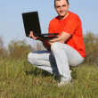 Boy with laptop — Stock Photo #13313376