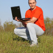 Boy in red t-shirt with PC — Stock Photo