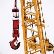 Stockfoto: Yellow crane with red hook