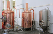 Copper tuns for brewing at a brewery — Stock Photo