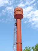 Red water tower — Stock Photo