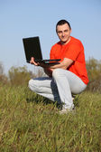 Boy with laptop — Stockfoto