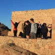 Stock Video: Pilgrims. Invocatory prayer. Moses Mountain. Sinai Peninsula. Egypt