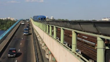 Blue train on the bridge — Stock Video