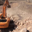 Big excavator operation in stone quarry — Stock Video #17155845