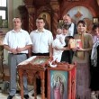 Christening of little baby in orthodox church. Infant baptism — Stock Video