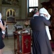 Vídeo Stock: Christening of little baby in orthodox church. Infant baptism