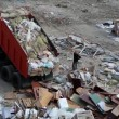 Stock Video: Dumper on landfill