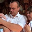 Mother and father with baby in orthodox church after christening ceremony — Stock Video