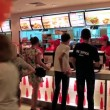 Stock Video: People inside fast food restaurant