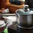 Saucepan on electric kitchen range — Stock Video