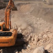 Big excavator operation in stone quarry — Stockvideo