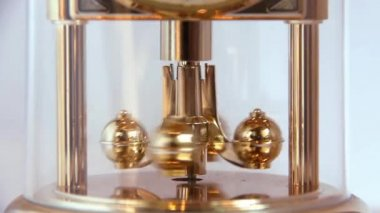 The spinning weights of a clock — Stock Video