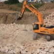 Big excavator operation in stone quarry — Stock Video #21491361