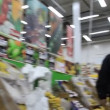 Stock Video: Buyer in supermarket
