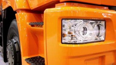 Halogen headlight of orange truck — Stock Video