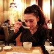 Woman eating miso soup in a Japanese restaurant — Stock Video