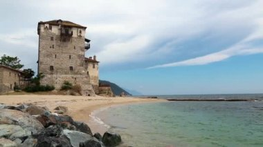 Old tower at the beach in Ouranoupoli, Athos peninsula, Chalkidiki, Greece — Video Stock