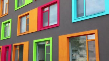 Building with many-coloured windows — Vídeo de Stock