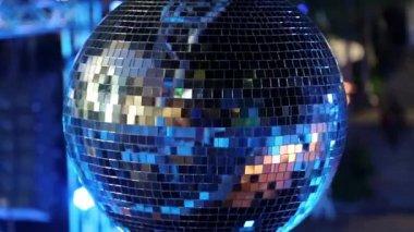 Spinning glitterball on dancefloor — Stock Video