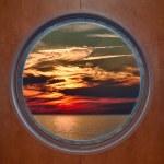 Dramatic Sunset Seen Through a Ship Porthole — Stock Photo #15331563