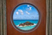 Ocean and Rock Through Porthole — Стоковое фото