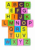 Houten blokken met letters op witte achtergrond — Stockfoto