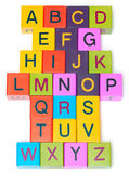 Wooden blocks with letters on white background — Stock Photo