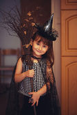 Little witch with broom — Stock Photo