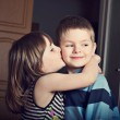 Adorable little girl kissing a boy — Stock Photo