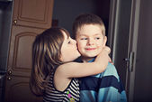 Adorable little girl kissing a boy — Photo