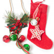 Stock Photo: Red Christmas stocking and jingle bells