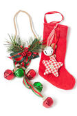 Red Christmas stocking and jingle bells — Stock Photo