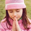 Little girl praying - Stock Photo